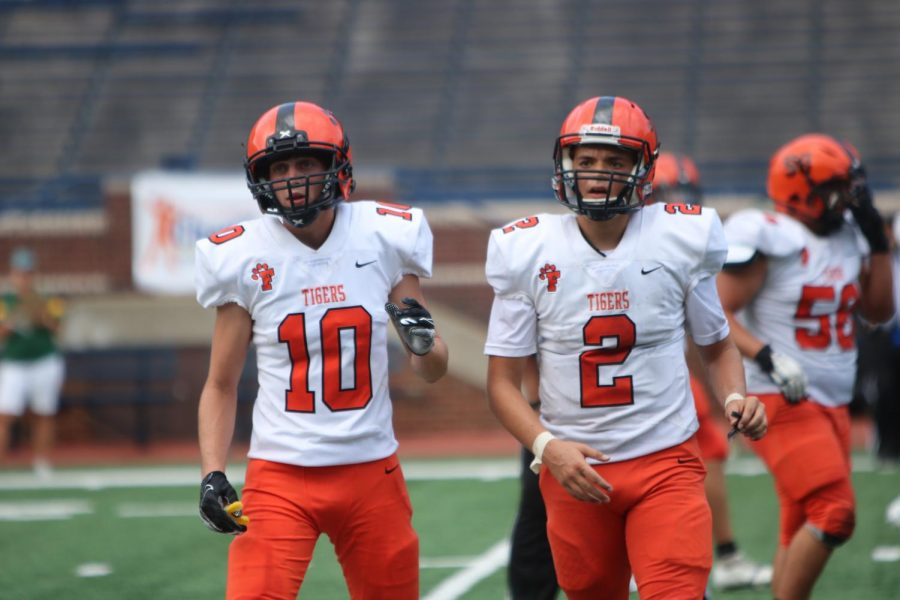 Junior Dylan Beverly along with his teammate Senior Seth Logan walking back to there coaches. The game at the Big House with there teammates behind them getting the line back together.