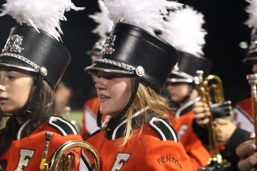 Sophomore Julia Blanchard walks with her bandmates after a Fantasia halftime show. On Sept. 10, the band played during the Flushing game.
