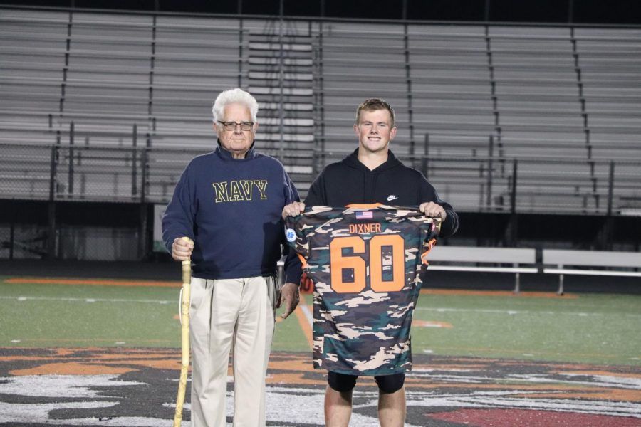 Junior John Dixner honors his grandfather on Heros Night. After playing Flushing on Sept. 10, the players give their jerseys to their heroes on the field.