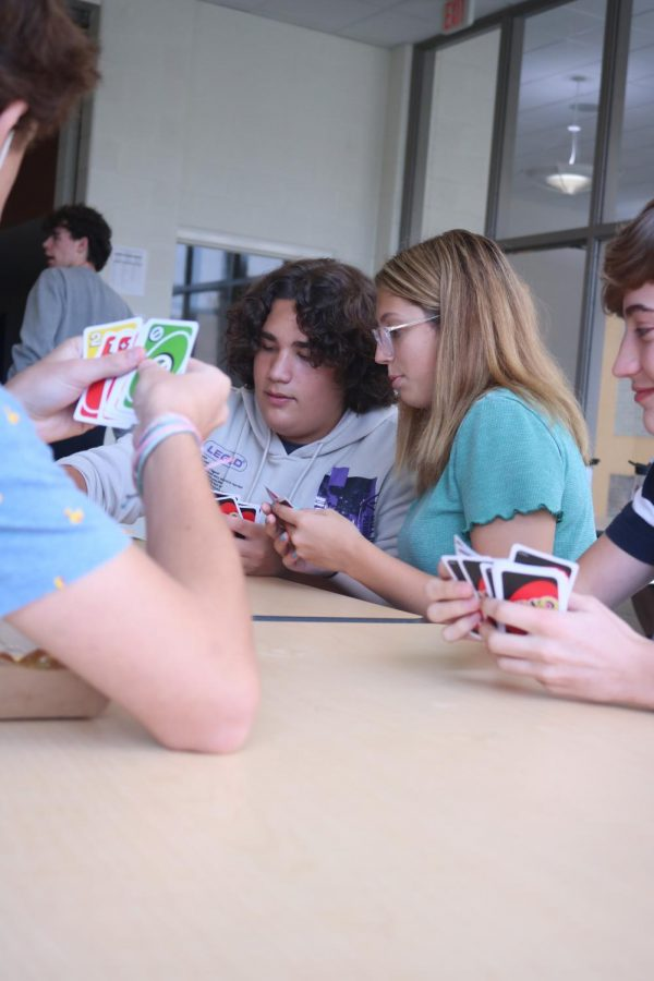 Junior Lance Sanchez participates in an Uno tournament with Sophomore Allison Bartholomew. An Uno tournament was held during lunch on Sept. 13-16 to raise funds for student leadership that will be put towards future student activities.