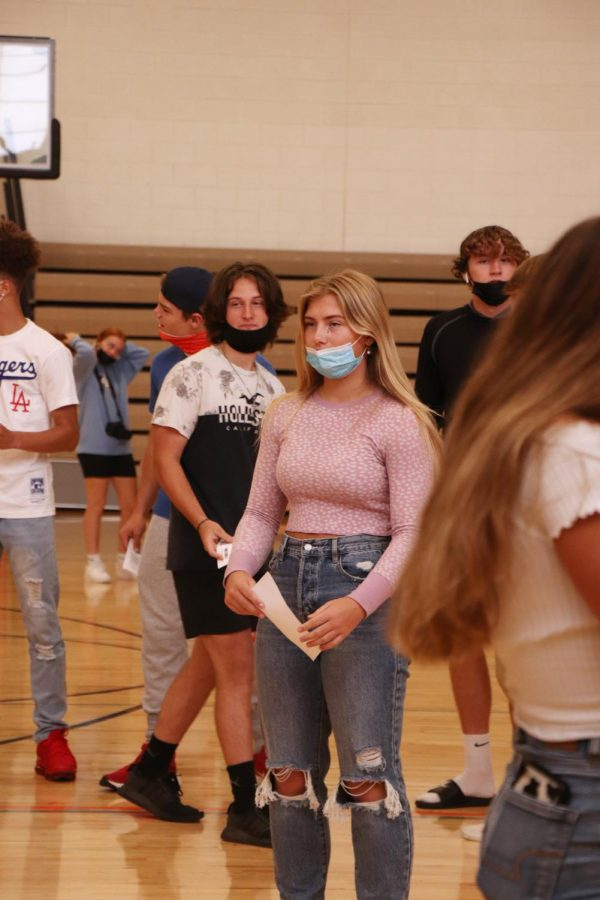 Sophomore Evelyn Hall waits to get her picture taken. Fenton High students had picture day with HSP Images on Sept. 14.