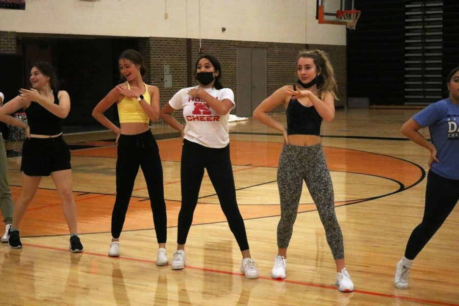 The dance team practices their routine for the pep assembly. On Oct. 8 the dance team learned their first dance since Covid-19.