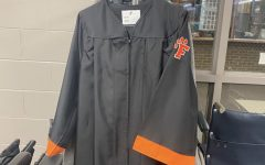 Opinion: Graduation gown design should be put to a vote
