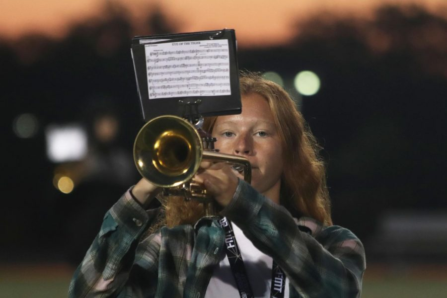 Sophomore Nina Frost practices Mr Blue during their morning practice before school. The Fenton High School Marching Band played Mr Blueout on the Fenton High School football field in the morning on Sept. 30.