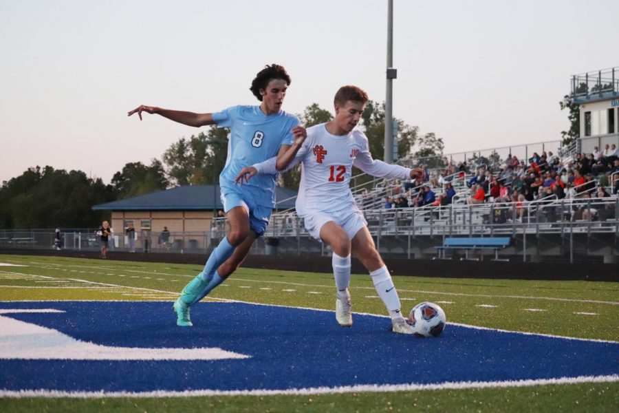 Sophmore Zachary Jones steals the ball from a Lake Fenton opponent. On Sept. 29, the Tigers defeated the Blue Devils 5-0.